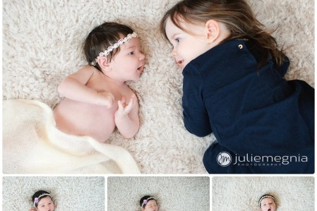Newborn girl with sister on faux fur